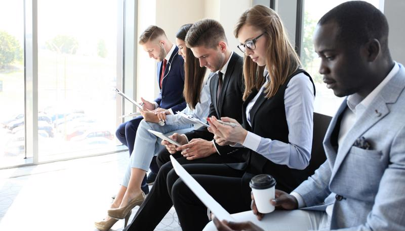 business people looking at phones